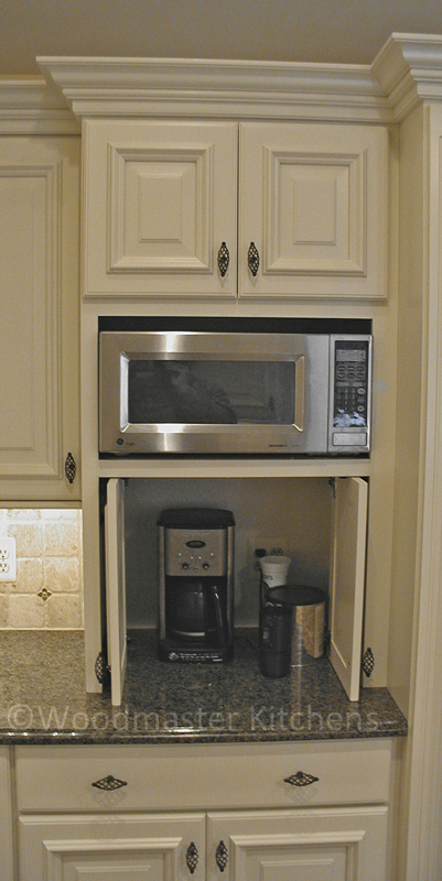 Kitchen cabinet featuring an appliance garage to store small appliances.
