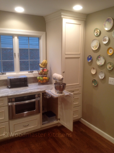 Kitchen cabinet with mixer shelf pull out storage.