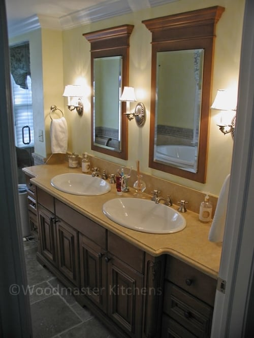Bathroom design with double vanity and two matching mirrors.