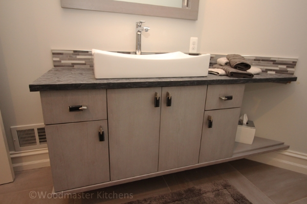 Contemporary bathroom design with a floating vanity cabinet.