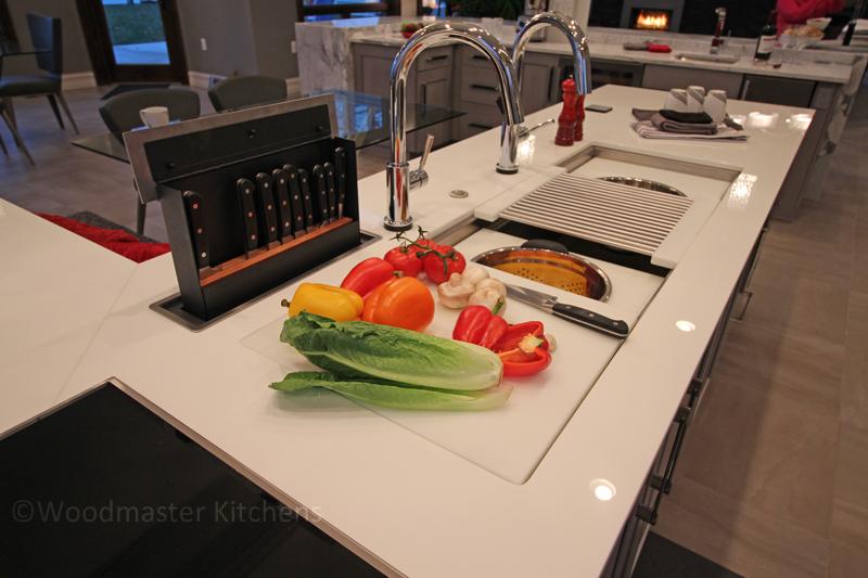 Contemporary kitchen design with hidden knife pop up storage.