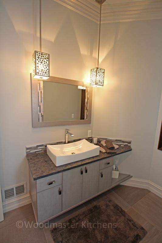 Contemporary bathroom design with ceramic tile floor.