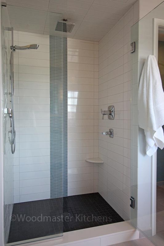 Bathroom design with corner storage shelf.