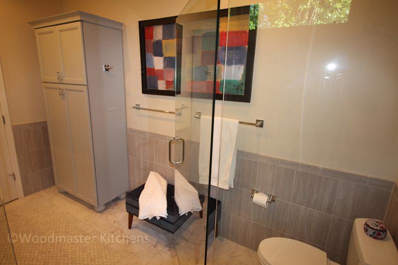 Bathroom design with towel bar and hooks.