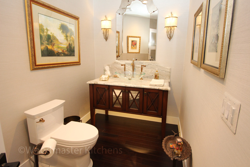 Powder room design with etched glass mirror and multi-layered lighting