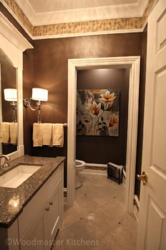 Bathroom design with dark color scheme.