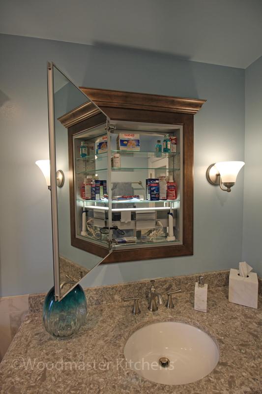 Bathroom design with framed medicine cabinet