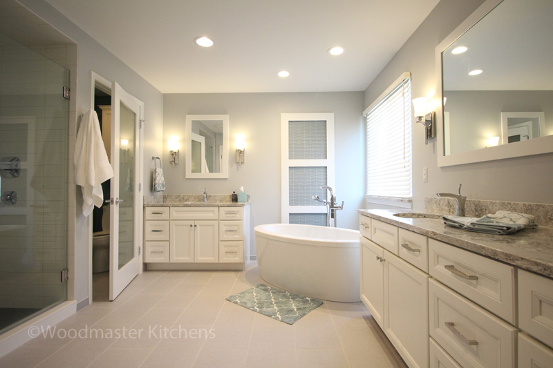 Bathroom design with mirrors and glass doors.