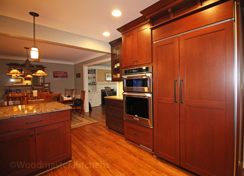 kitchen design with medium wood finish cabinetry