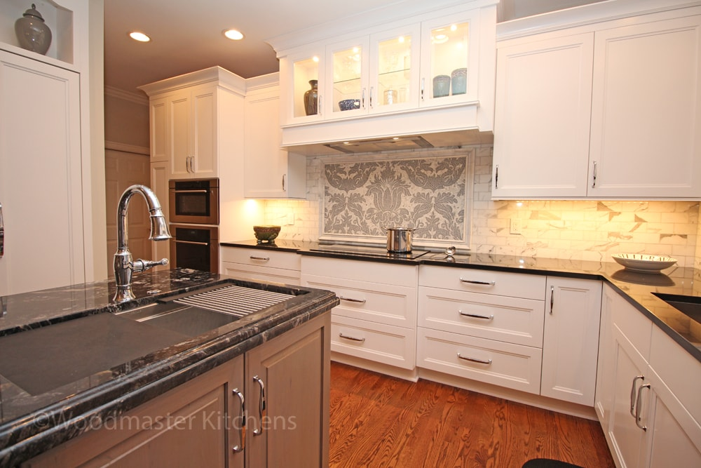white kitchen design with dark countertop