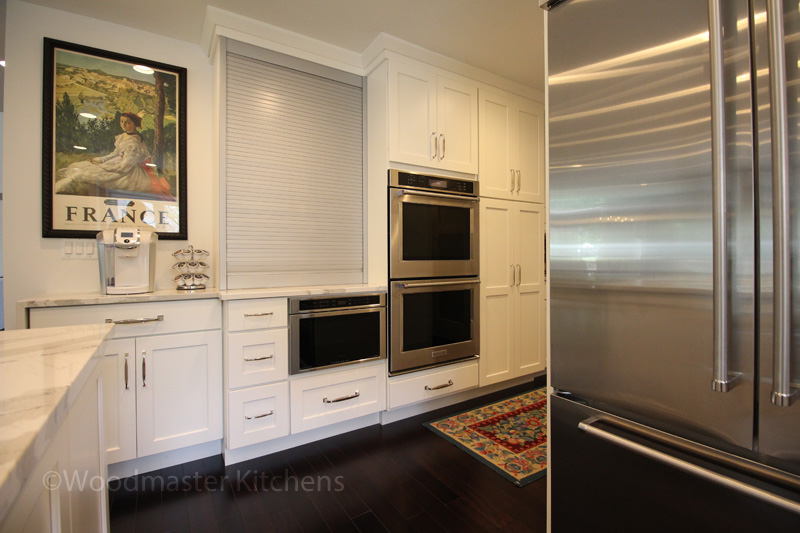 White kitchen design with stainless steel appliances