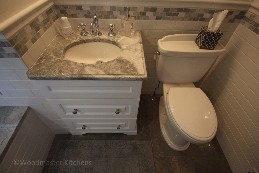 Bathroom design with oval sink.