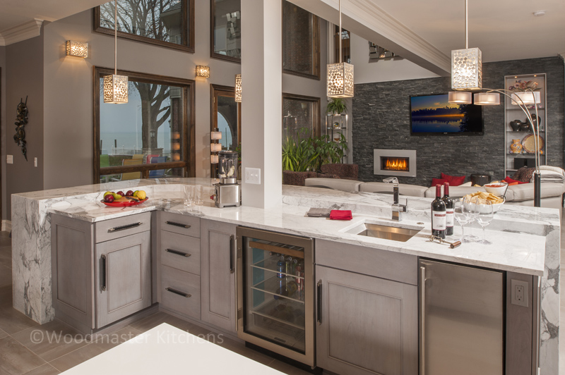 Large kitchen design with beverage center in the island.