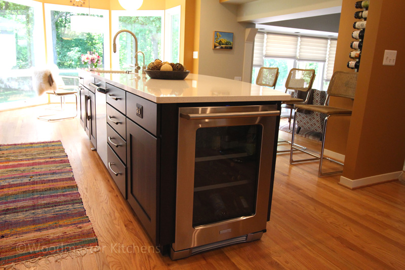 Kitchen design with undercounter wine refrigerator.
