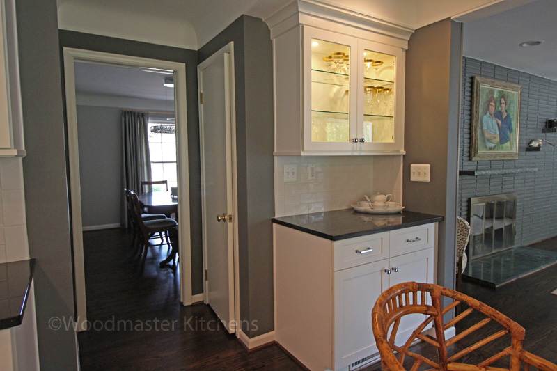 Small beverage bar with display cabinets and work space.