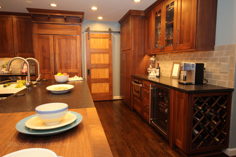 Beverage center with wine storage and work space.
