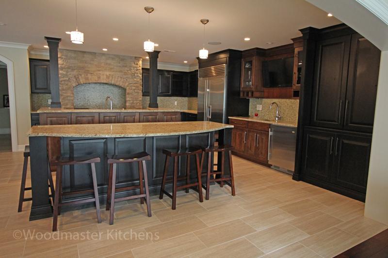 Basement kitchen design with beverage center.