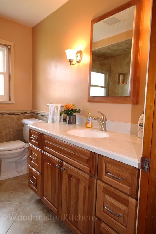 Traditional bathroom design with wood tone vanity.