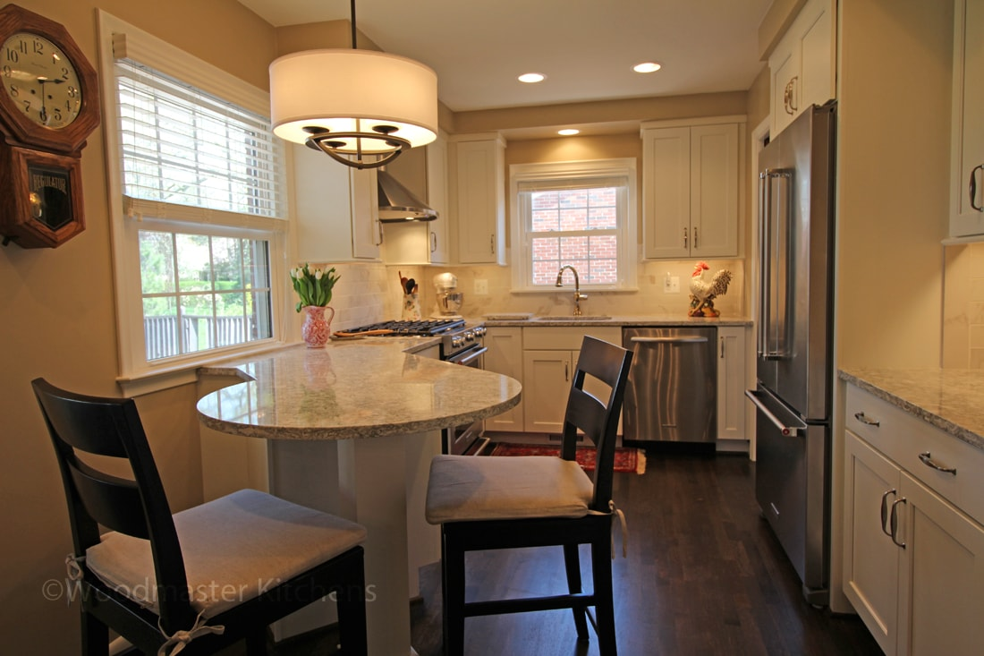 Compact kitchen design with drum shade pendant light