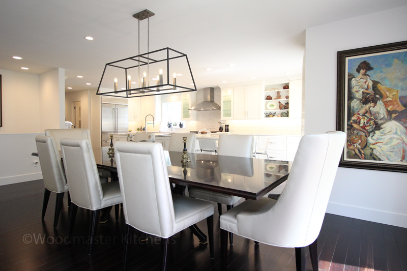 Contemporary kitchen design with long modern chandelier