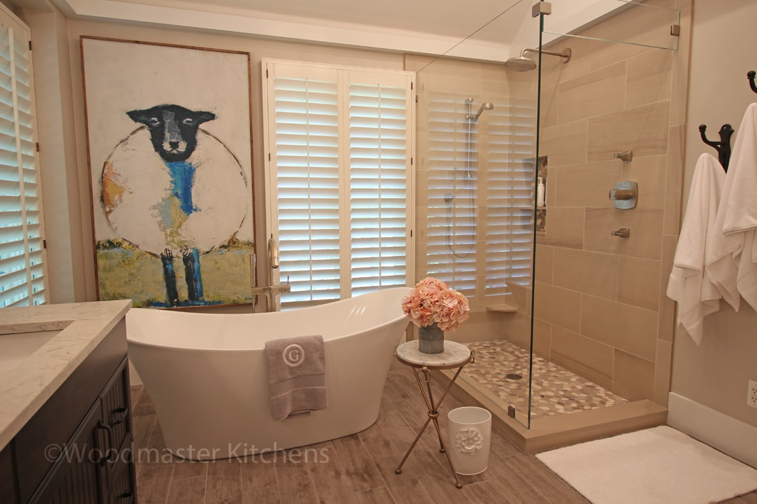 Bath design with freestanding tub and glass shower