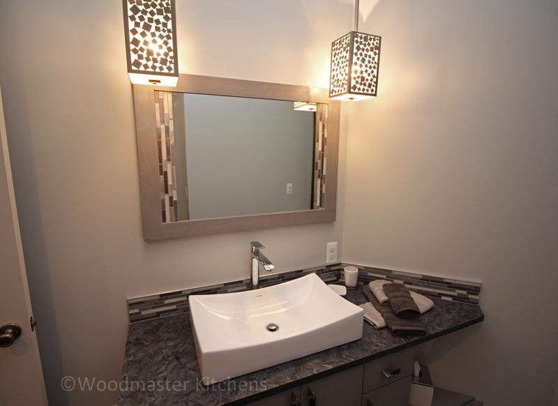 Dark countertop with white vessel bathroom sink