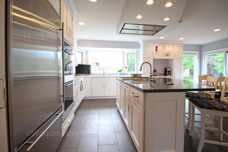 white kitchen design with stainless appliances