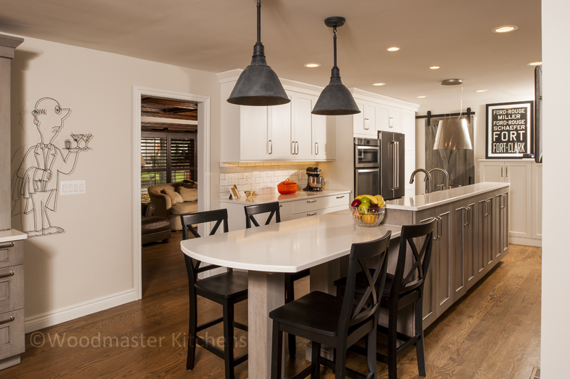 Kitchen design with metal hood and pendant lights