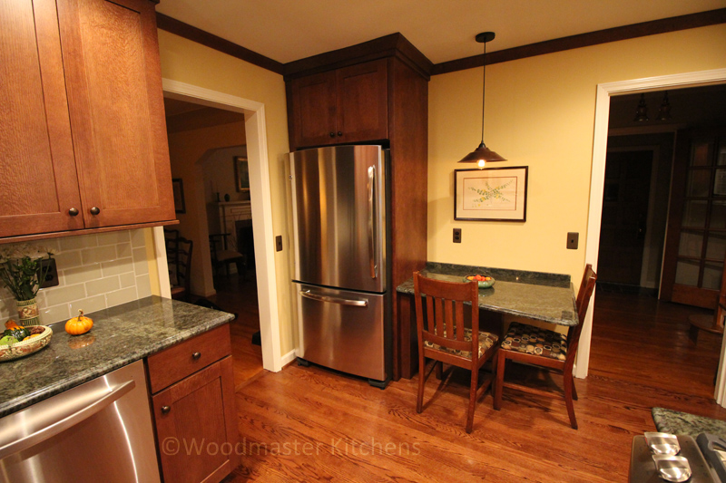 Kitchen design with wood cabinets and green tabletop