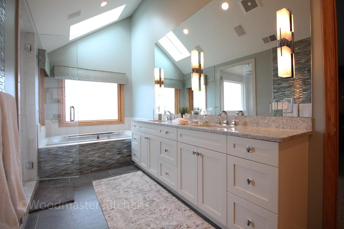 Bathroom design with large vanity cabinet