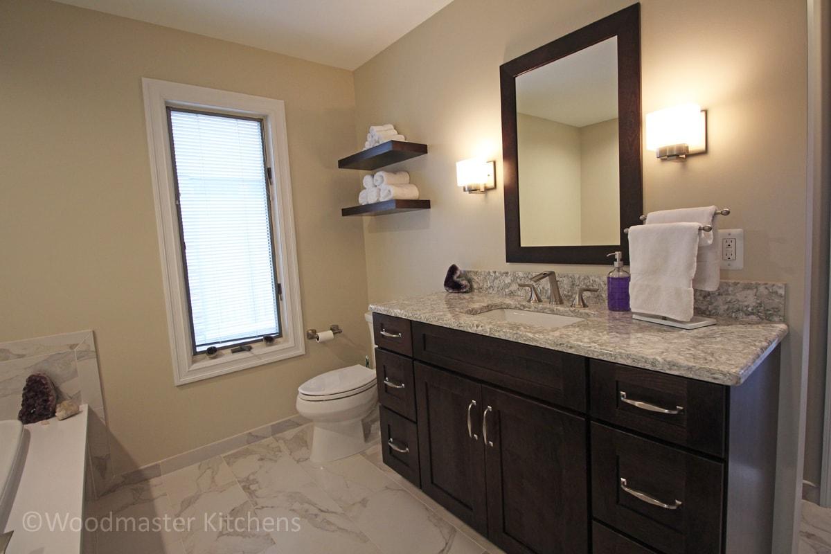 Bath design with dark wood cabinets