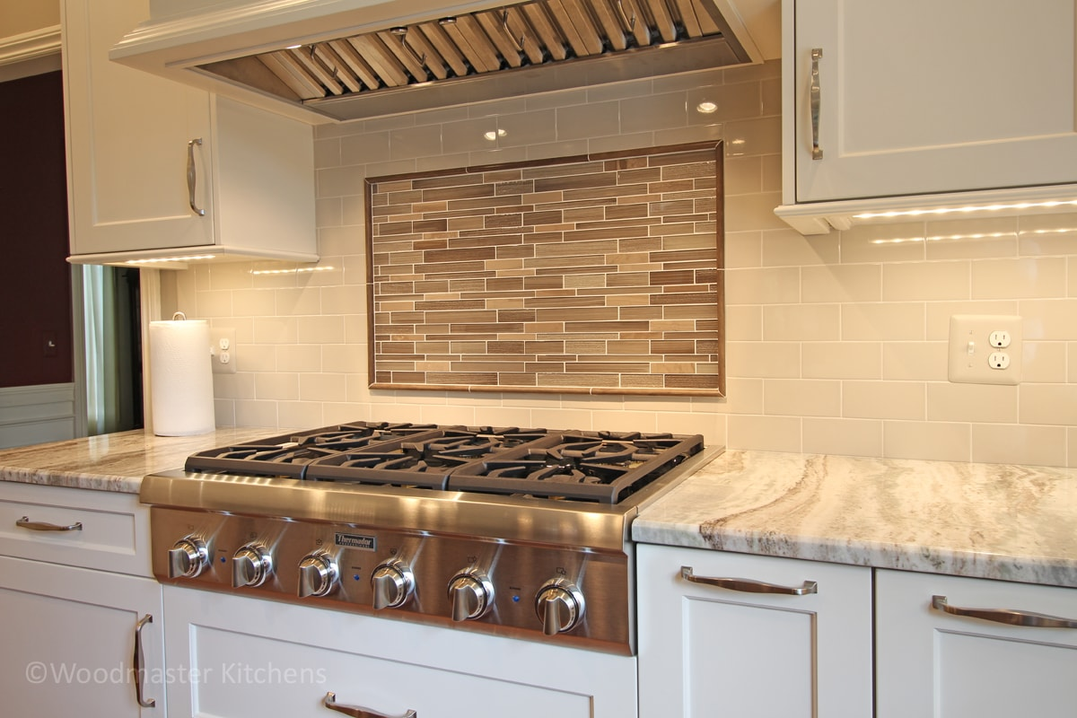 cooktop in a white kitchen design
