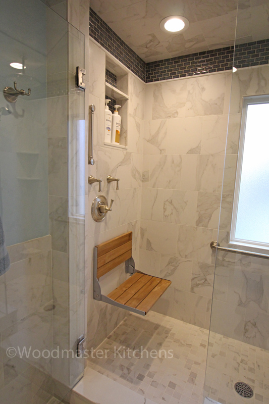 shower design with wooden fold out seat