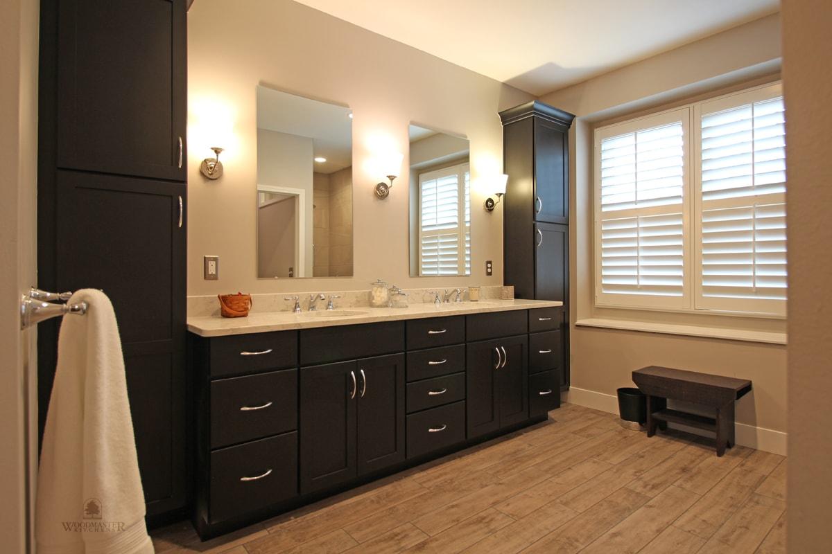 master bath design with dark wood vanity