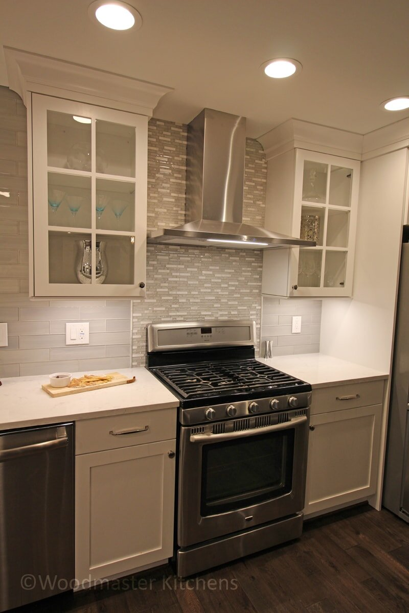 kitchen design with a chimney range hood