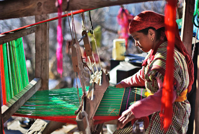 Himachal woman weaving woolen shawl.