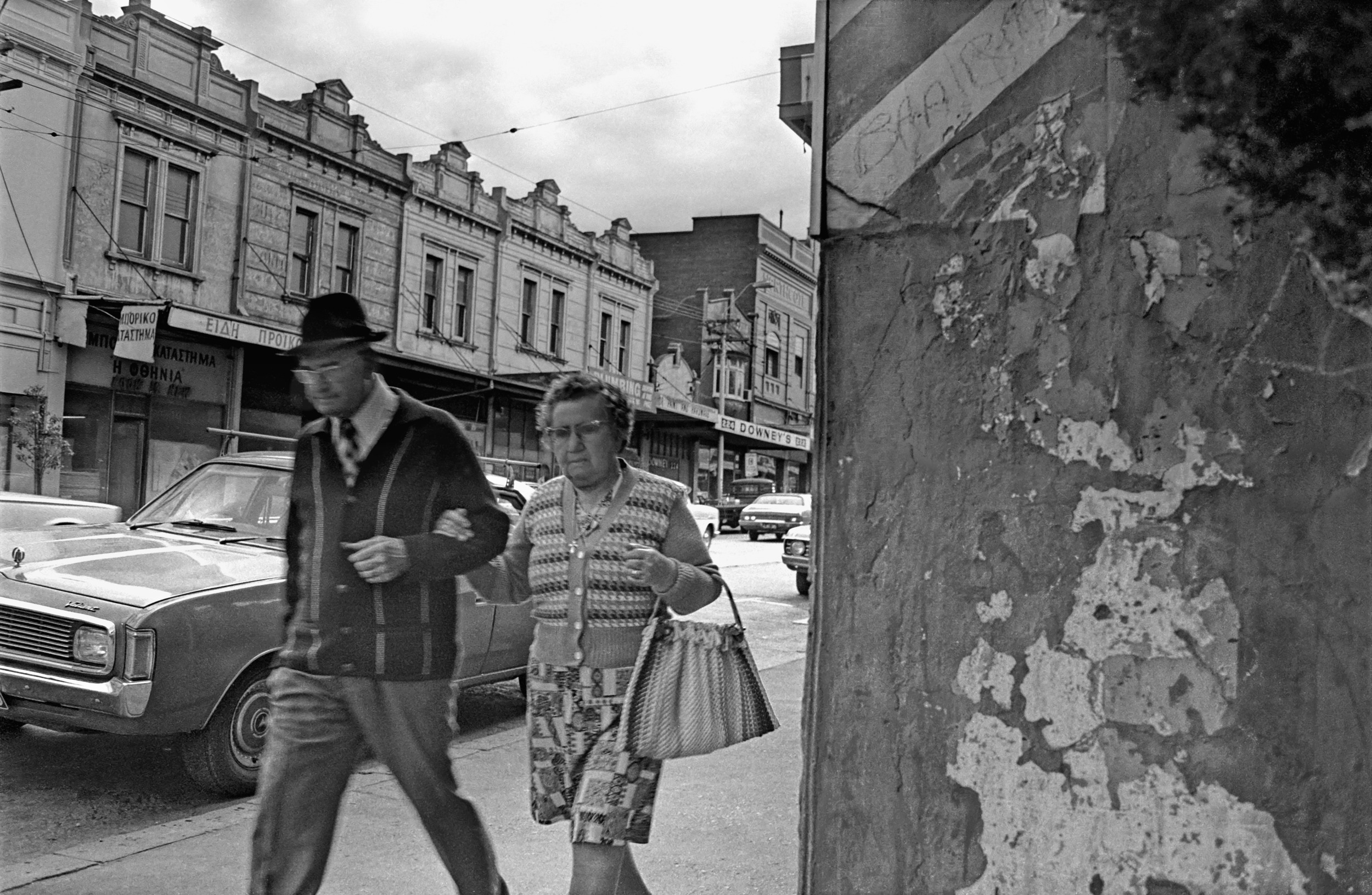 David Wadelton, 247 High Street Northcote, couple walking, 1976.