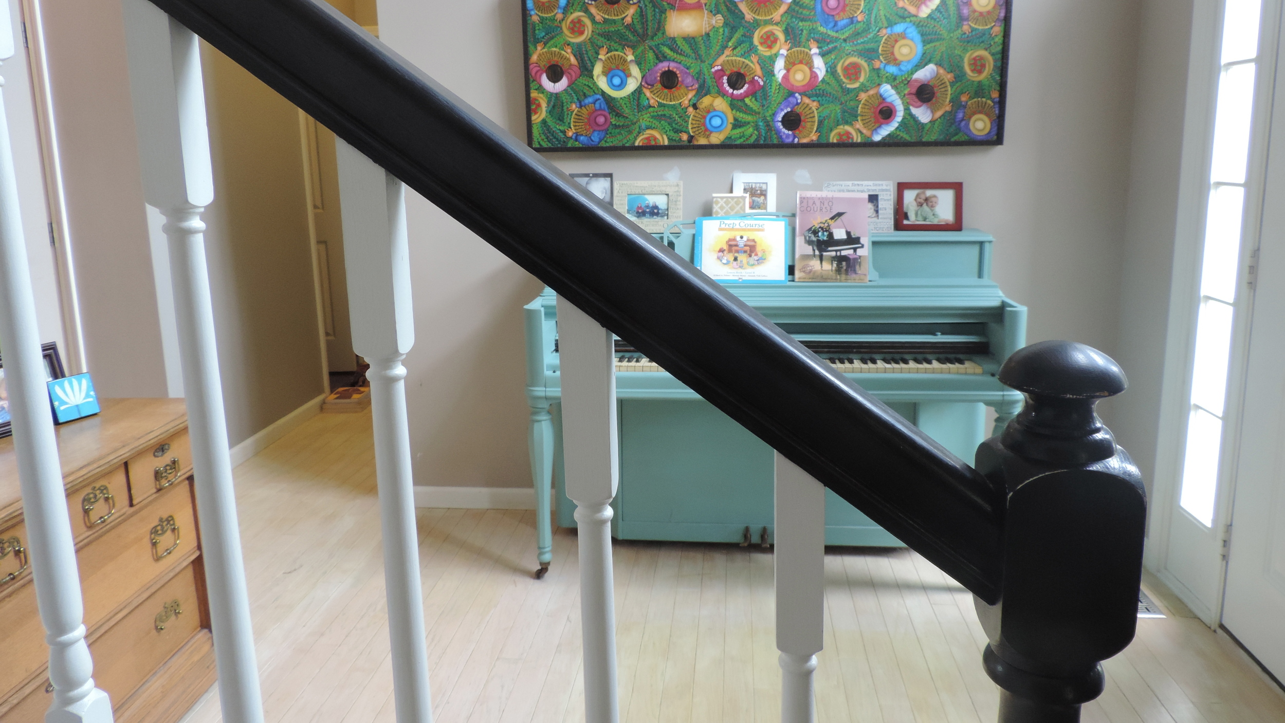 This glossy black banister used to be stained oak until this client and friend of mine did this rockin' DI-Herself upgrade.