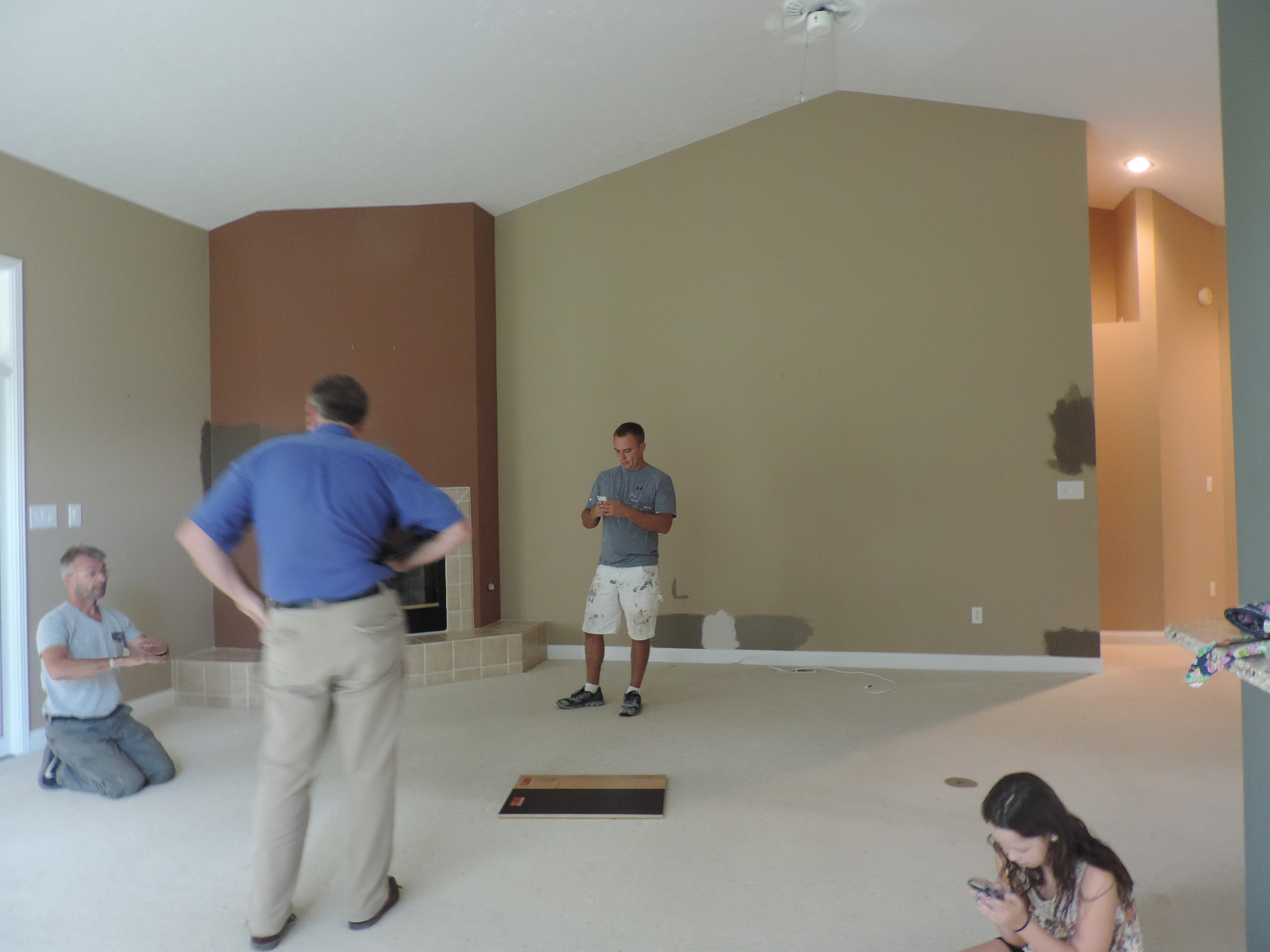 Never mind these people (men discussing installation things, child getting too much screen time): just check out the space. Okay, actually, note that I am thrilled to be working with JL Benton Contracting again and Carpets Plus Colortile on this project.