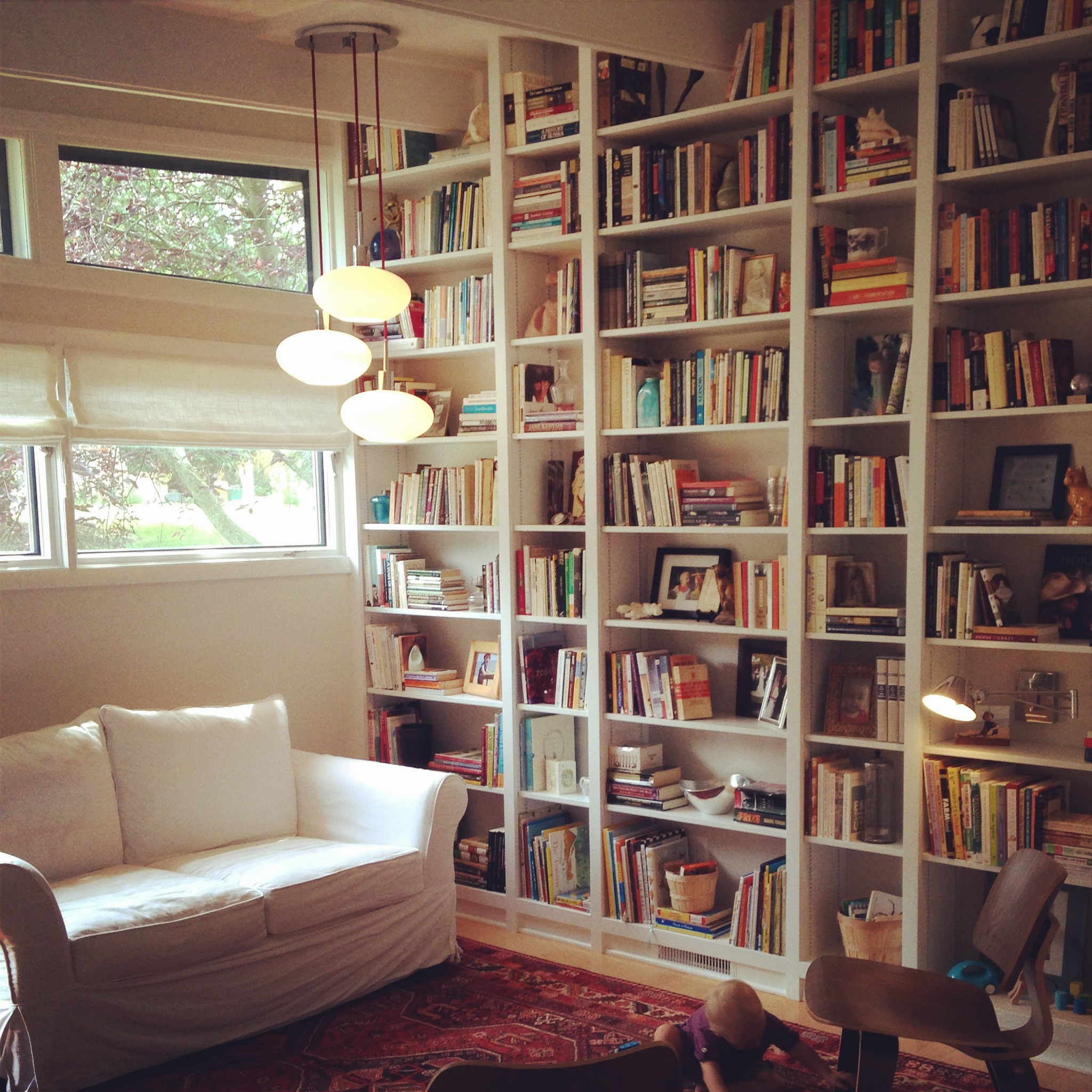 Lots of poetry books here. I love this house, and I loved getting to peruse all the books while we staged the shelves: Anne Frank and Emily Dickinson and Virginia Woolf, oh my! (Nb. New sofa still to come!)