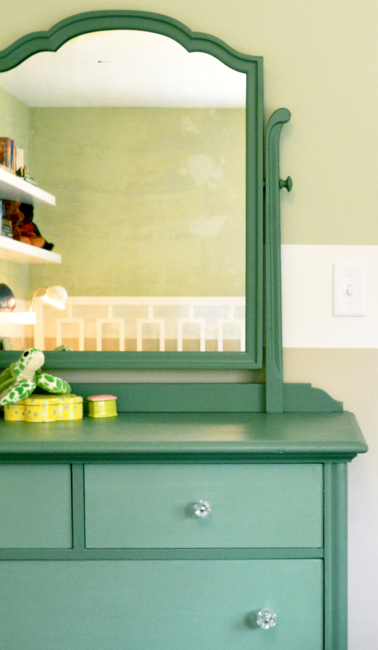 Yellow-toned Guilford Green on the wall, coexisting beautifully with neutral Grant Beige (HC-83) below it and a custom-painted blue-green dresser in front (Webster Green HC-130 and Lehigh Green HC-131).