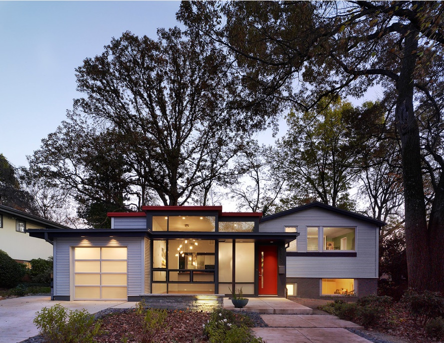 Here, the front of an oh-so-traditional split-level was bumped out to make the split-level appear more mid-century hip than the traditional dull. You can check out the project on the architect's site to see the before images in addition to interior shots.Courtesy of  Balodemas Architects.