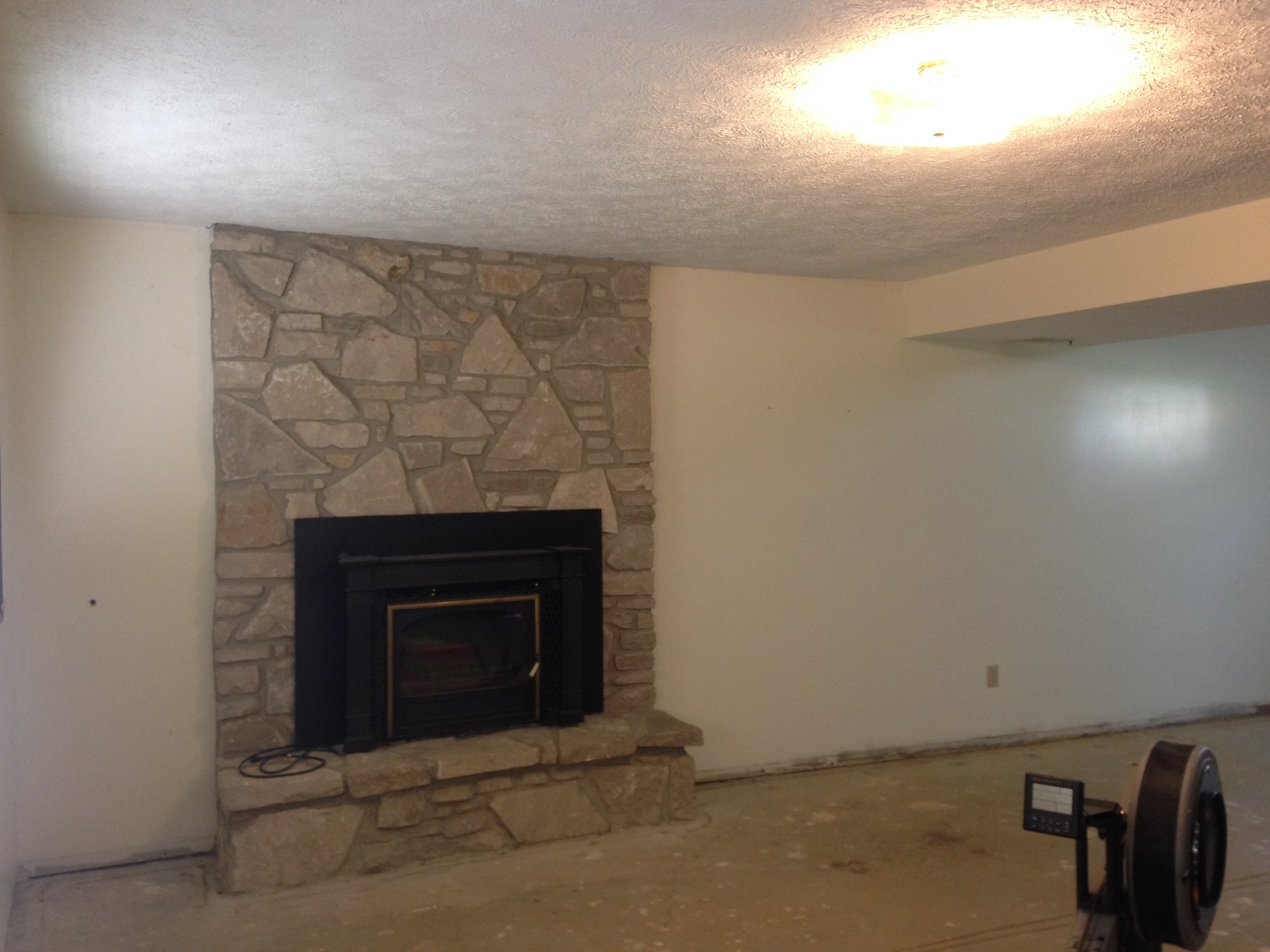 Before. Your standard lower-level, bi-level family room. Complete with the fireplace.