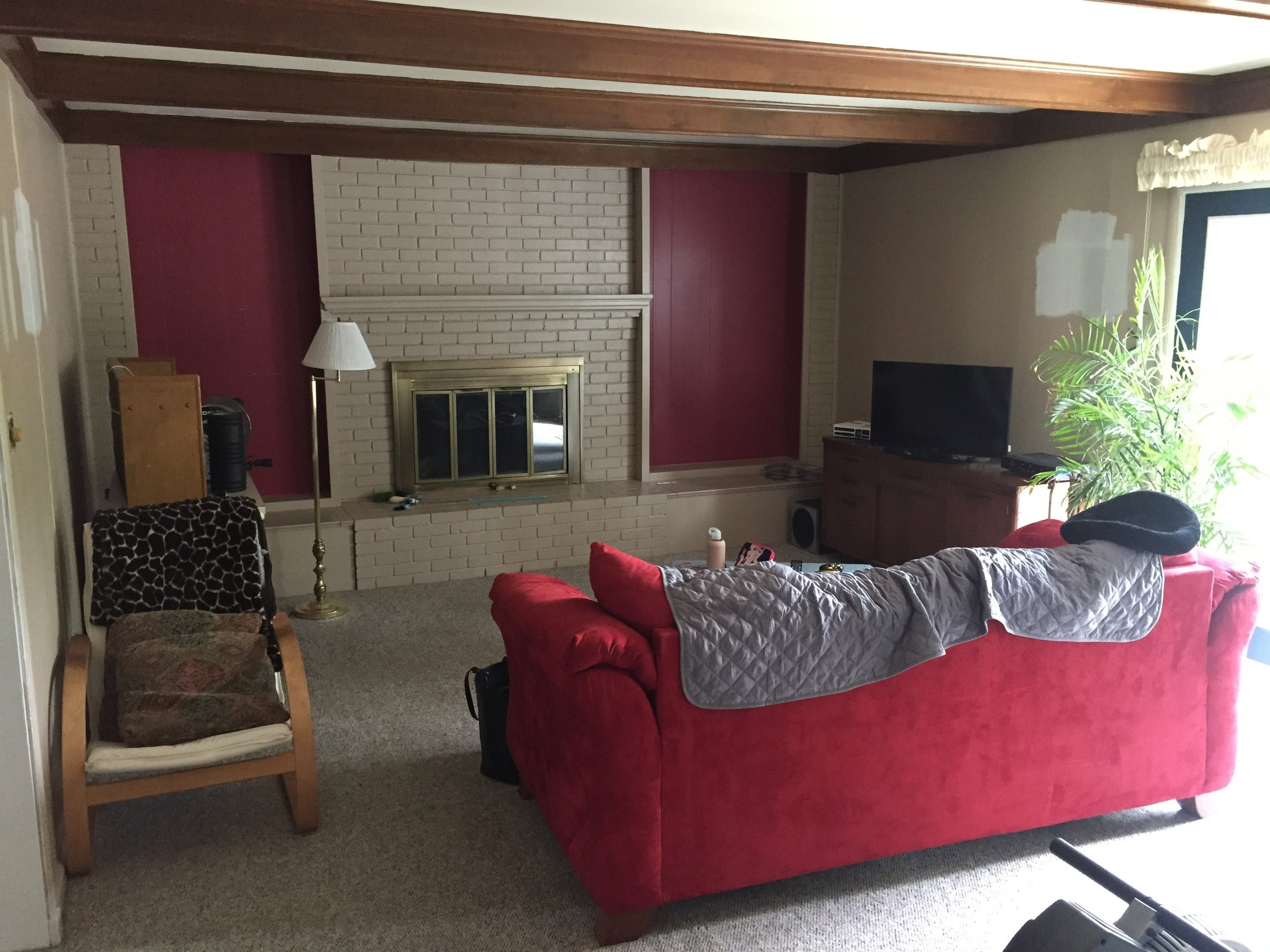 Before of the family room. Traditional lower level family room in a split-level.