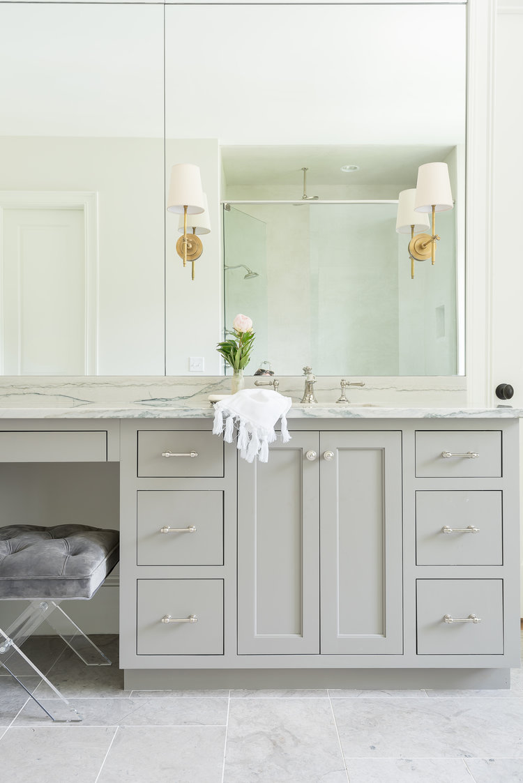 "Everything in this bathroom is polished chrome (or nickel - hard to tell), except those sconces, which very subtly say 'hey! the person who lives here is  interesting  and  classy.""   Photo used courtesy of  Parkes & Lamb ."