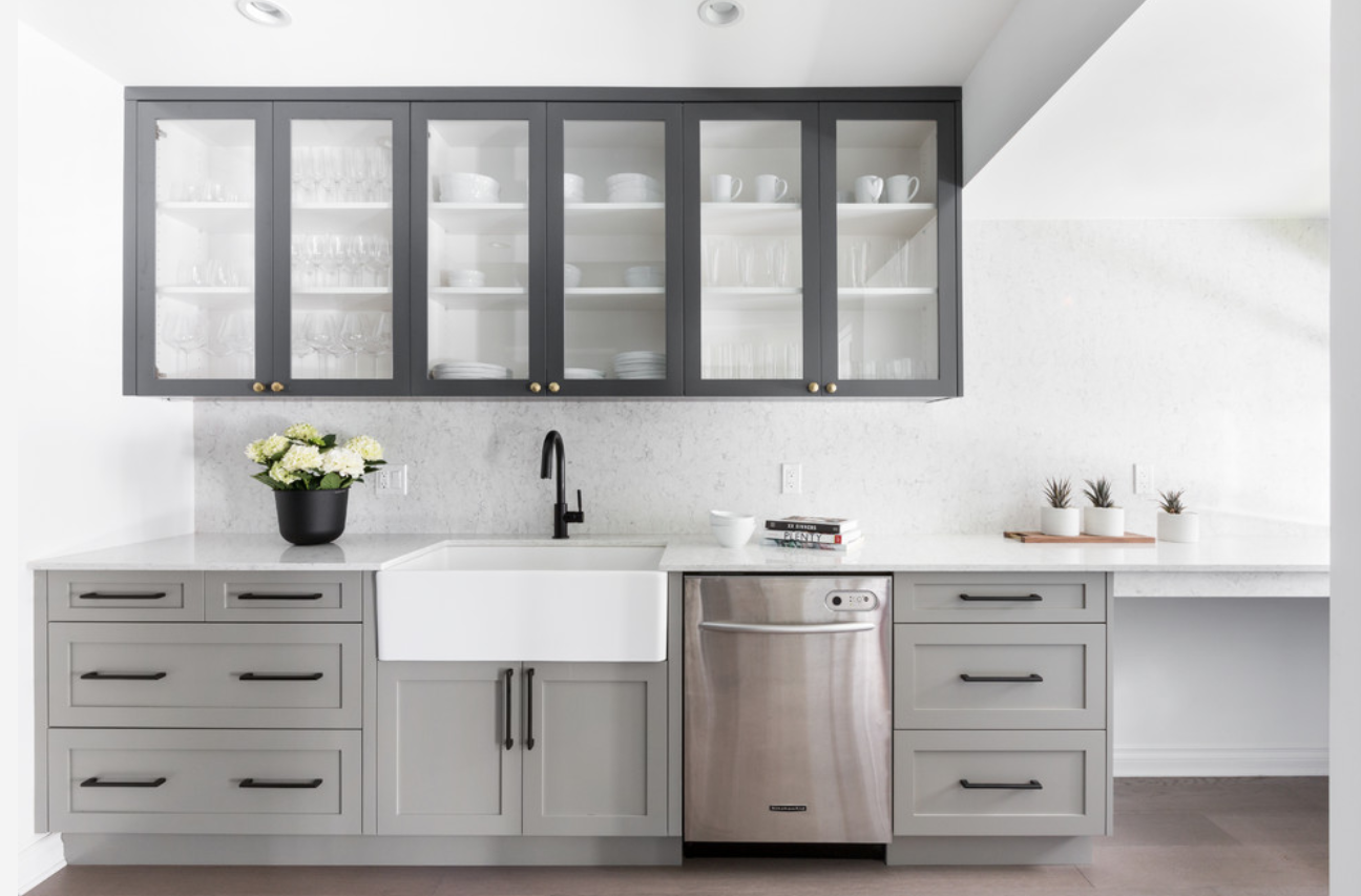 Another example of consistent fixture finishes except for one element that is a departure—those dainty little knobs on the upper cabinets. The black upper cabinets tie to all the black fixtures below, and the little bits of brass contrast against them. Photo used courtesy of  MAK Interiors.