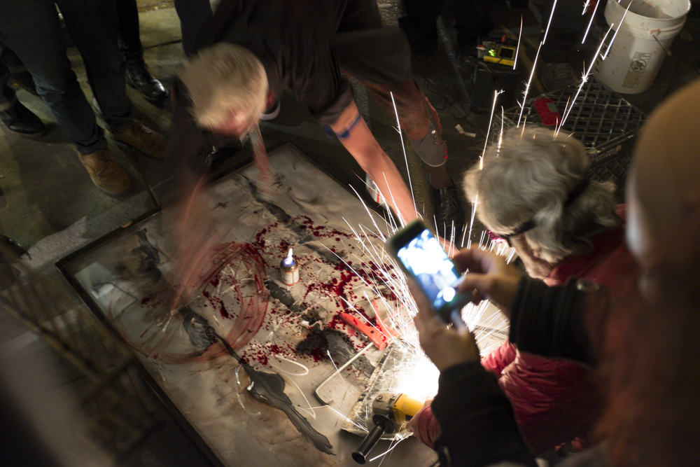 This crazy artist dude painting with his own blood after he tapped an artery