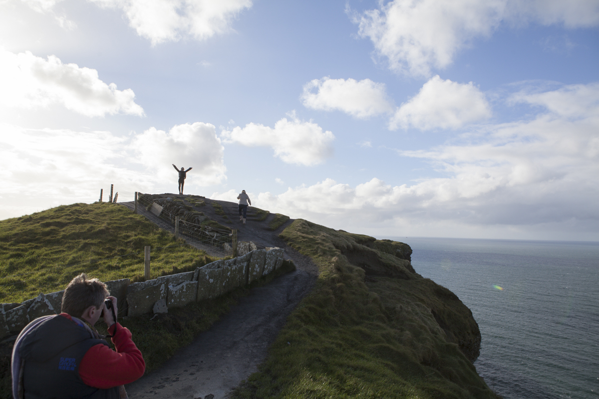 People posing up on the edge of the cliff. It gets pretty windy up there. She was brave as she was also wearing 3 inch heel boots.