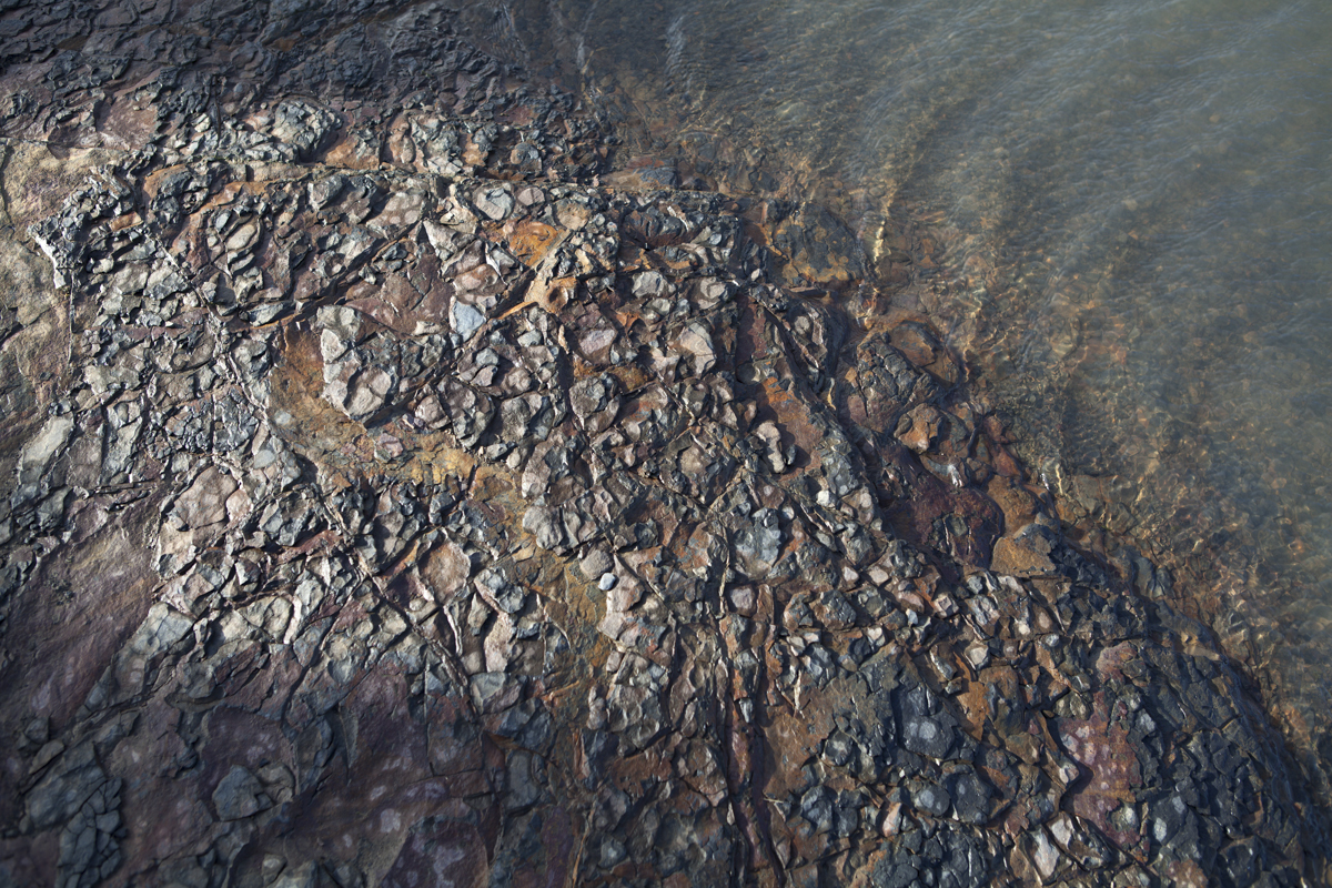 Some nice rocks near a pool.