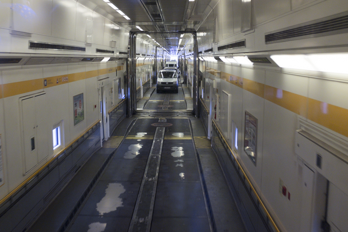 This is taken from the back of the bus - you can see the cars sort of lining up and the bus gets its own sort of cabin. Once the train starts going you can actually get out and walk around the cabin of the car. Theres bathrooms and everything. Pretty crazy.